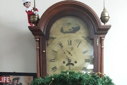 Find Dewey the Elf on the Bookshelf